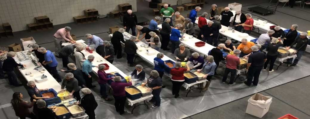 Employees packaging meal donations