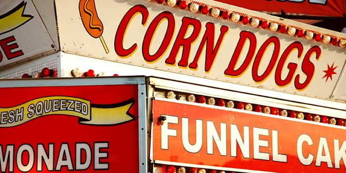 A collection of signs advertising State Fair style foods.