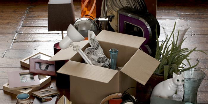 Large collection of household decorations in a cardboard box.