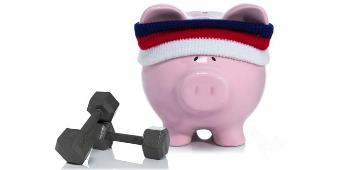 An image of a piggy bank wearing a headband, posed with dumbells