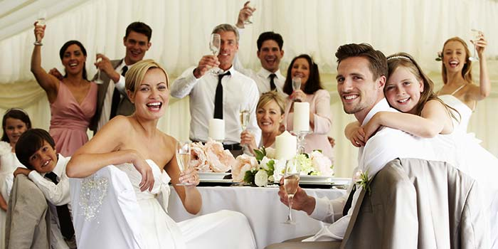 Bride and groom enjoying a toast at their wedding reception.