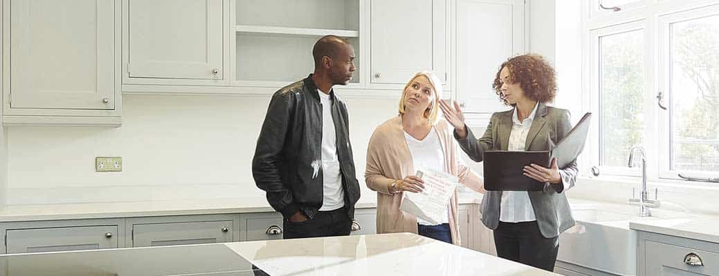 Couple speaking with a realtor