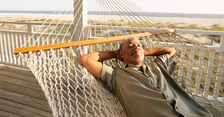 Retired man sleeping on hammock